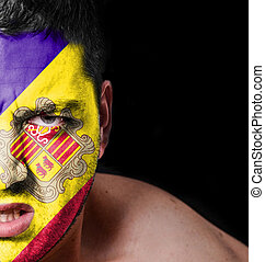 Portrait of angry man with painted flag of Andorra