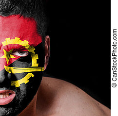 Portrait of angry man with painted flag of Angola
