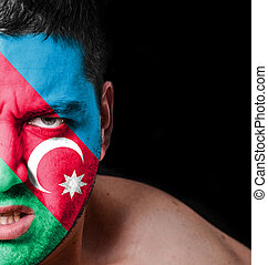 Portrait of angry man with painted flag of Azerbaijan