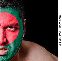 Portrait of angry man with painted flag of Bangladesh