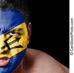 Portrait of angry man with painted flag of Barbados
