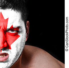 Portrait of angry man with painted flag of Canada