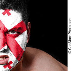 Portrait of angry man with painted flag of Georgia