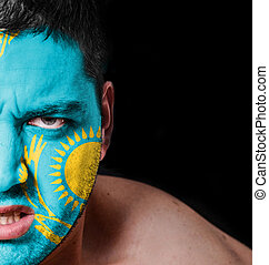 Portrait of angry man with painted flag of Kazakhstan