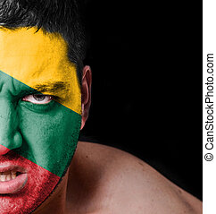 Portrait of angry man with painted flag of Lithuania