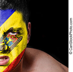 Portrait of angry man with painted flag of Moldavia