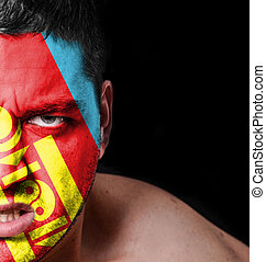 Portrait of angry man with painted flag of Mongolia