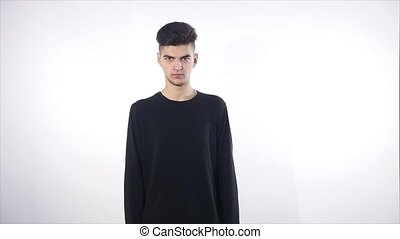 portrait of angry serious young man, boy isolated over white...