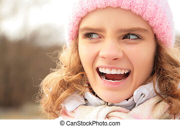 Portrait of angry young girl outdoor in winter