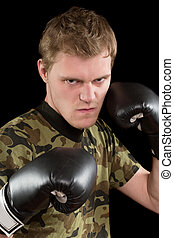 angry young man in boxing gloves