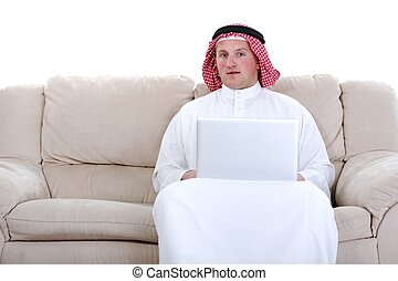 Arabic man using laptop at home