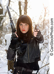 Portrait of armed beautiful young lady