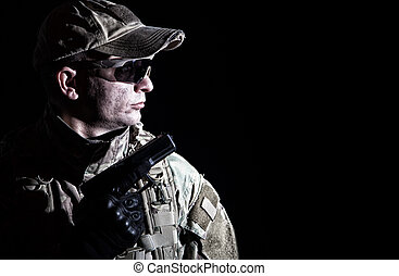 Portrait of army soldier armed service pistol