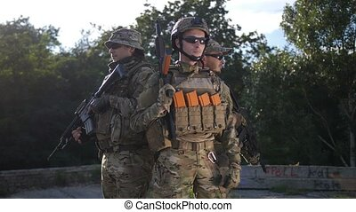 Portrait of army soldiers with weapons in uniform