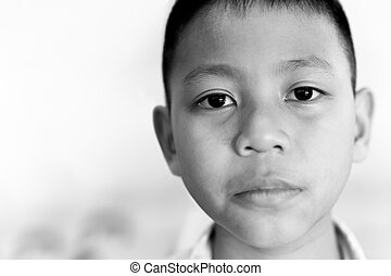 Portrait of asian boy crying with tear on his face in black and white.
