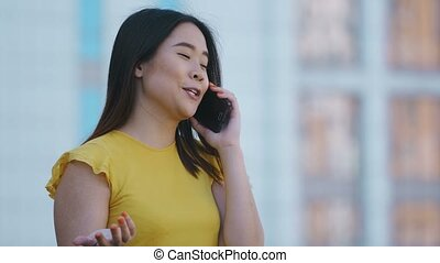 Portrait of asian business lady talking on phone