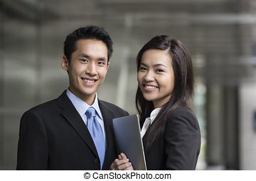 Portrait of Asian business partners.