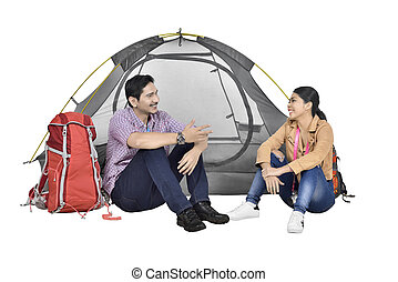 Portrait of asian couple discussion in front of tent