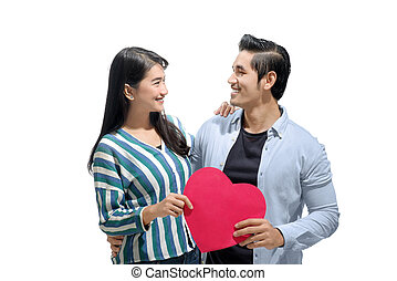 Portrait of asian couple holding a red paper heart together