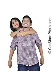 Portrait of asian couple in love having fun