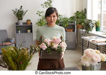 Portrait of Asian Florist Holding Flowers