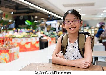 Portrait of Asian girl in supermarket