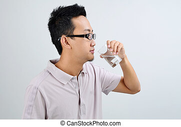 Asian man drinking mineral water