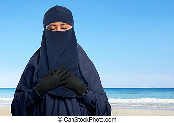 Portrait of asian muslim woman in hijab with niqab with...