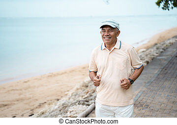 senior male running and exercising outdoor