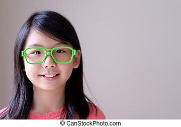 Portrait of Asian teenager with big green glasses