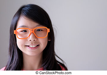 Portrait of Asian teenager with big orange glasses