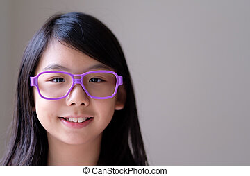 Portrait of Asian teenager with big purple glasses