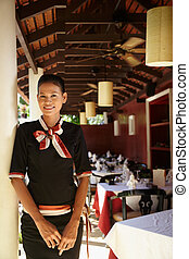 portrait of asian waitress working in restaurant