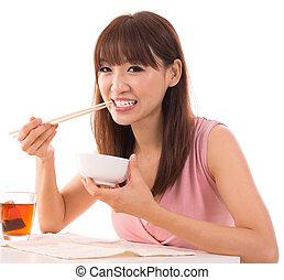 Asian woman eat rice