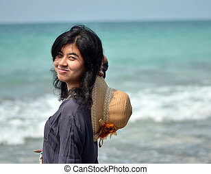 Portrait of asian woman on beach