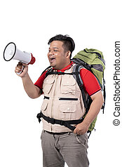 portrait of asian young backpacker screaming with megaphone