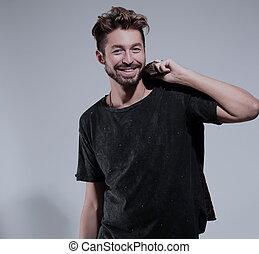 Portrait of asmiling handsome man  over gray background