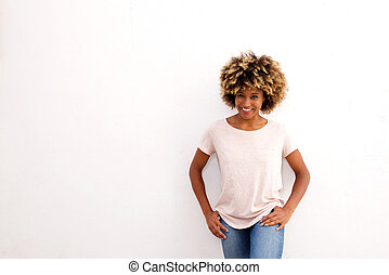 attractive black woman standing against white background