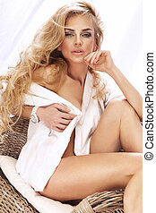 Portrait of attractive blonde girl with long curly hair. -...