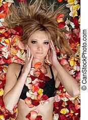 attractive blonde lying in rose petals
