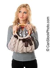 Portrait of attractive blonde with a handbag