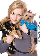 Portrait of attractive blonde with two dogs. Isolated