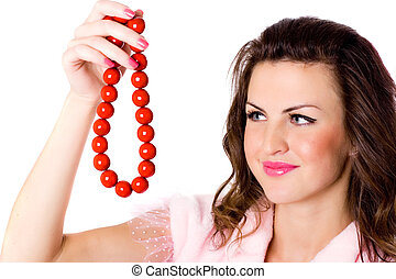 attractive brunet woman with red beads