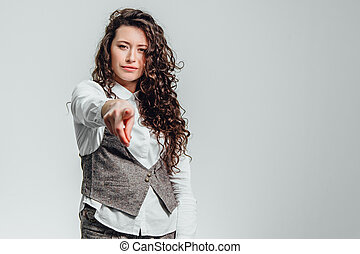 Portrait of attractive business woman on white background. With plenty of copy space. With beautiful curly hair.