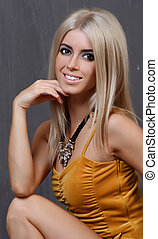 Portrait of attractive caucasian smiling woman blond