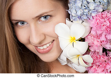 portrait of attractive caucasian smiling woman with flowers