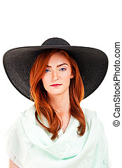 Portrait of attractive elegant woman in black hat