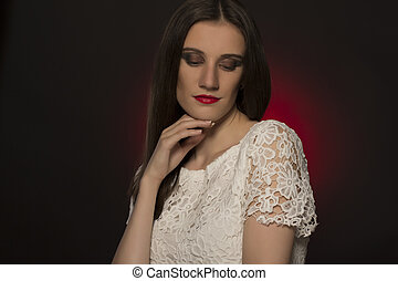 Portrait of attractive fashionable woman on dark background