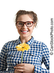 Portrait of attractive girl in glasses with flower