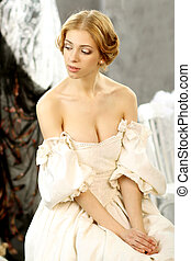 Portrait of attractive girl in vintage dress with a plunging neckline